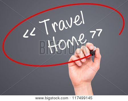 Man Hand Writing Travel - Home With Black Marker On Visual Screen