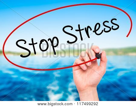 Man Hand Writing Stop Stress With Black Marker On Visual Screen
