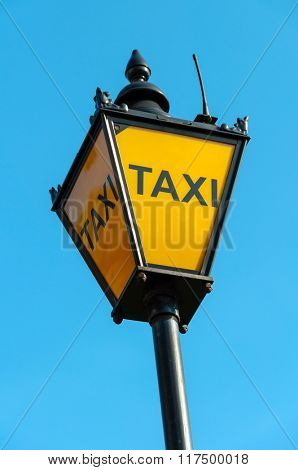 Vintage taxi sign in London, UK