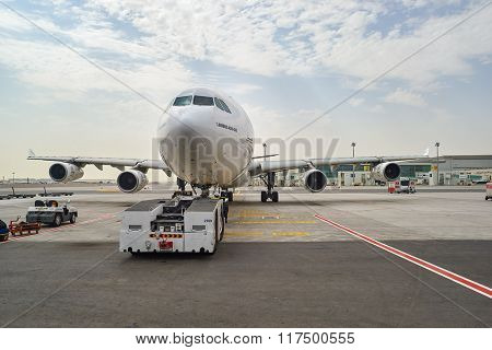 DUBAI, UAE - JUNE 23, 2015: Emirates Airbus A340-300 in Dubai airport. Dubai International Airport is a major airline hub in the Middle East, and is the main airport of Dubai.