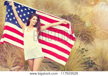 woman holding USA flag outdoor.