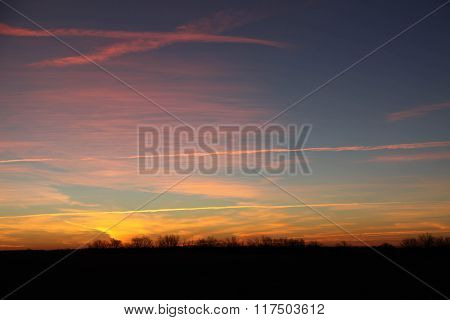 Sunrise with Jet Contrails