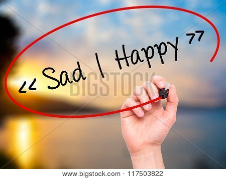 Man Hand Writing Sad - Happy With Black Marker On Visual Screen.