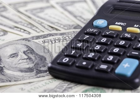 portrait of Franklin on the dollar and calculator