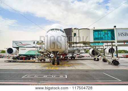DUBAI, UAE - JUNE 23, 2015: Airbus A380 docked in Dubai airport. Dubai International Airport is a major airline hub in the Middle East, and is the main airport of Dubai.