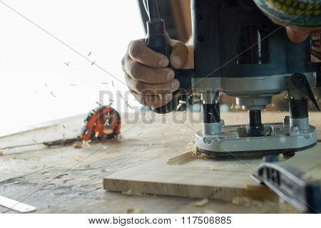 Carpenter tools on wooden table with sawdust.