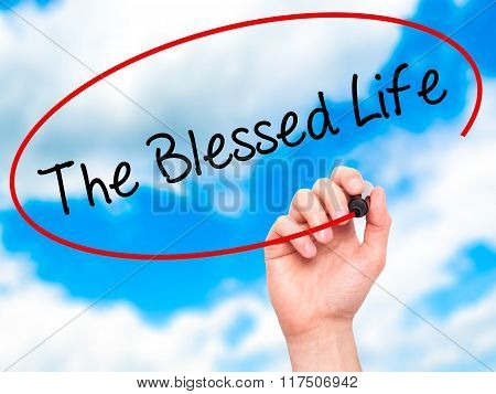 Man Hand Writing The Blessed Life  With Black Marker On Visual Screen.