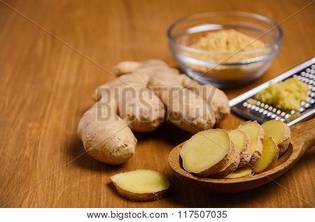 Ginger root on wooden table.