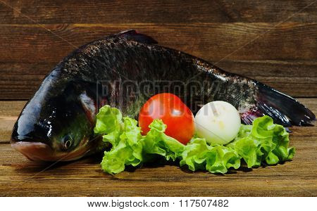 Raw Fish On Wooden Table As Background