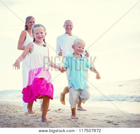 Family running on the beach Relaxation Concept