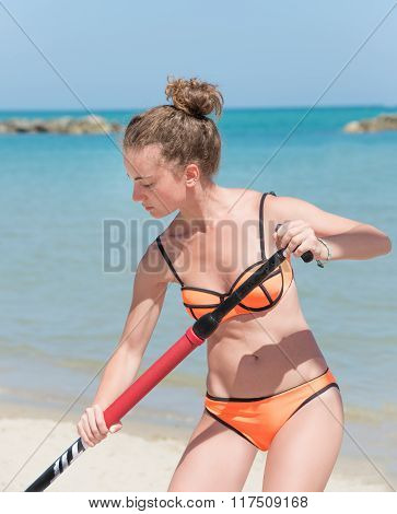 Girl On Stand Up Paddle