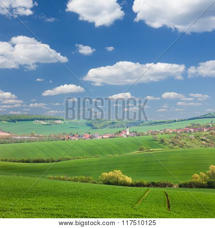Panorama of  Little town on the green hills, blue sky, beautiful buildings and nature, traditional architecture, summer vacation concept, Europe, Czech Republic
