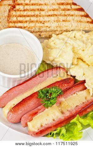 Appetizer - sausages with cheese, omelette toasts and sauce