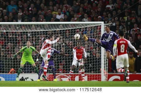 LONDON, ENGLAND - NOV 04 2014: Davy Roef of Anderlecht makes a clearance  during the UEFA Champions League match between Arsenal from England and Anderlecht from Belgium played at The Emirates Stadium