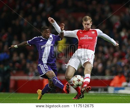 LONDON, ENGLAND - NOV 04 2014: Oswal Alvarez of Anderlecht and Arsenal's Per Mertesacker during the UEFA Champions League match between Arsenal from England and Anderlecht from Belgium