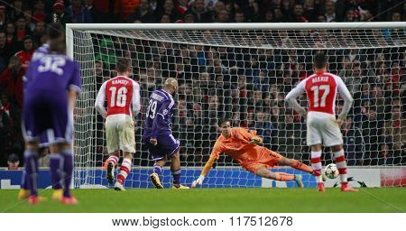 LONDON, ENGLAND - NOV 04 2014: Nathan Kabasele of Anderlecht scores a penalty  during the UEFA Champions League match between Arsenal and Anderlecht from Belgium played at The Emirates Stadium.
