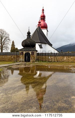 Cristian Kostol sv. Ladislava in Slovakia. Reflection in water
