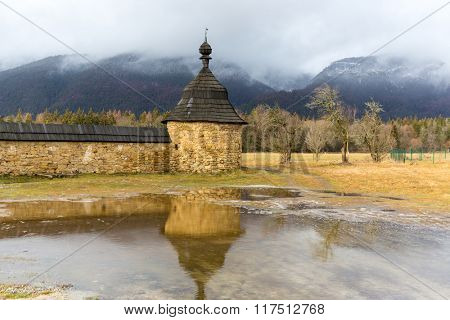 scene with old tower and water reflection, Kostol sv. Ladislava in Slovakia