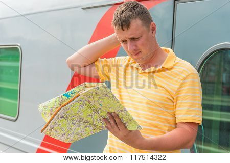 The Man With A Map Costs About The Train At The Station