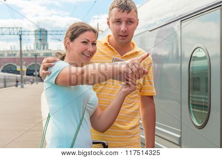 Girl Shows Her Husband The Direction Of The Train Station