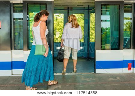 Passengers Enter The Doors Of Subway Train