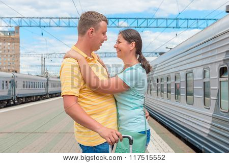 Couple Hugging At The Train Station After A Long Separation