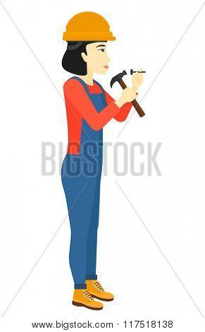 Woman hammering nail.