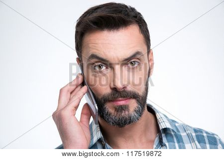 Closeup portrait of a man talking on the phone and looking at camera