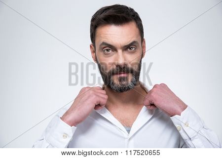 Confident businessman looking at camera isolated on a white background