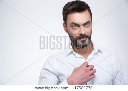 Handsome businessman looking away isolated on a white background