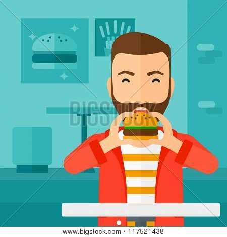 Man eating hamburger.