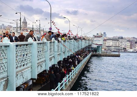 Fishermen Fishing On The Galata Bridge Over The Golden Horn.