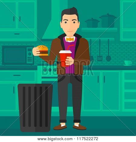 Man throwing junk food.