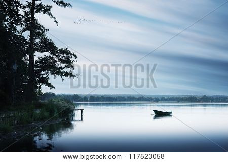 roawing boat floating over water