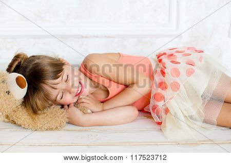 The Little Ballerina Sleeps On A Teddy Bear