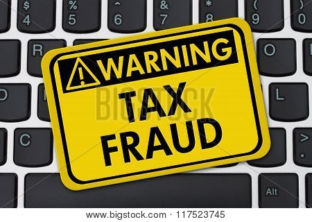 Online Tax Fraud, Computer Keyboard And Yellow Warning Sign