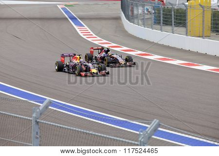 Daniel Ricciardo Red Bull Racing overtaking Carlos Sainz Toro Rosso