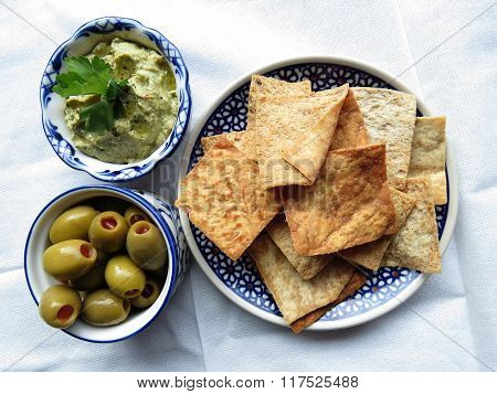 Snacks With Hummus, Chips And Olives
