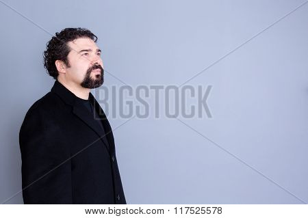 Hopeful Man Looking Away Over Gray Background