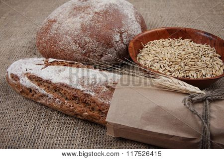 Brown different breads on sackcloth background