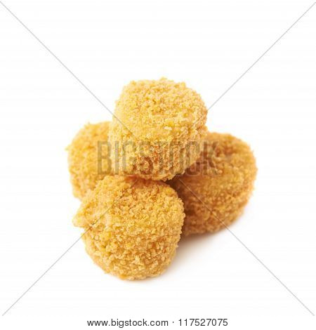 Pile of breaded crab balls isolated