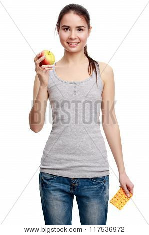 Young Smiling Woman Holding A Pill In One Hand And An Apple In The Other