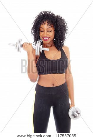 African American Woman With Two Dumbbell's.