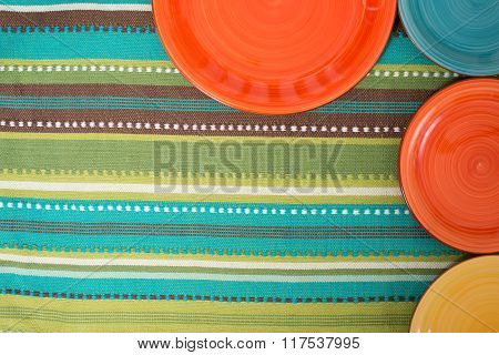 ?olored Plates On The Striped Green Cloth