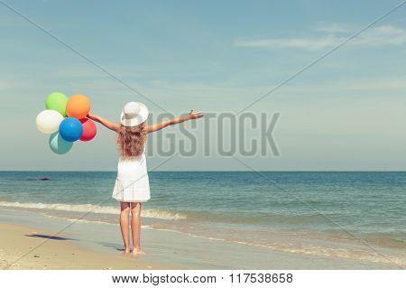 Teen Girl  Standing On The Beach