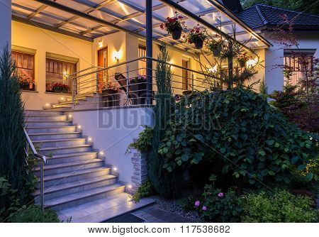 House With Garden In The Evening