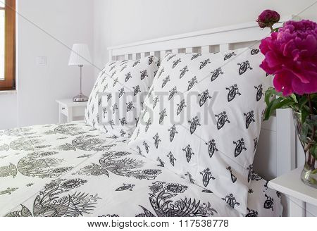 White Bed With Elegant Pillows