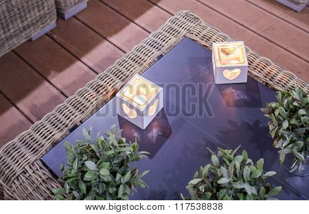Stylish Candleholders On Glass Table