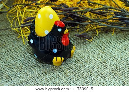 black chicken with colorful Easter egg