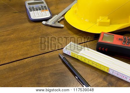 Safety Helmet And Tools To Architect On Wooden Background